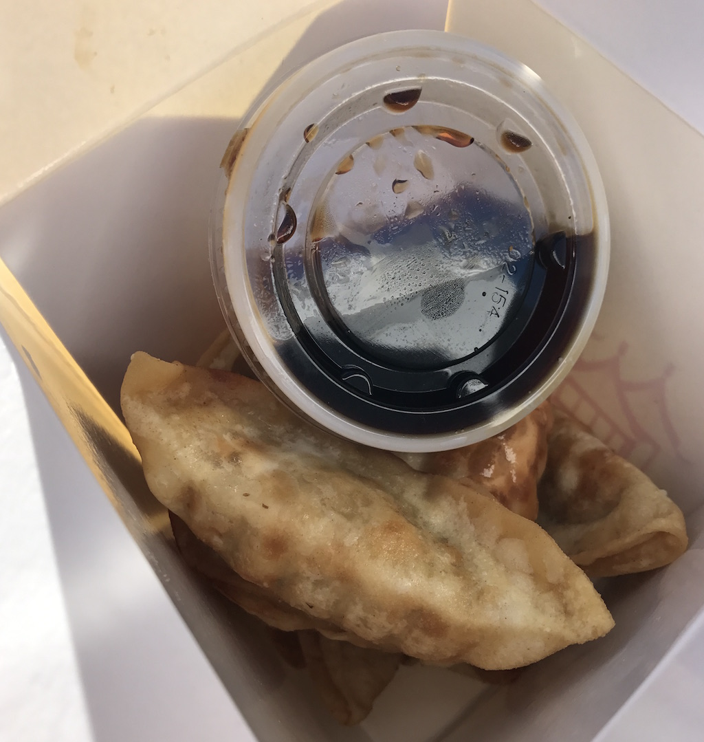 Potstickers and sauce.